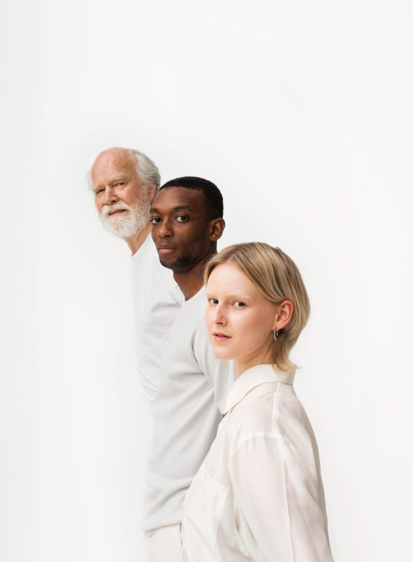 Photo of three people dressed in white