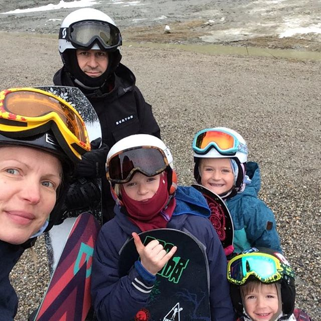 A man, a woman and three children in their ski equipment.