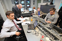 Teemu Turunen (left) in the Ministry's situation awareness room from which crisis activities were led after the earthquake in Japan. Photo: Eero Kuosmanen.
