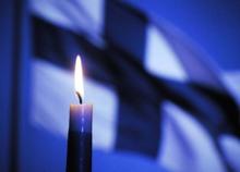Vela e bandeira da Finlandia